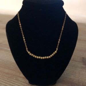 Gold bead necklace